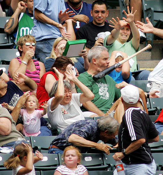 I don't know who took this photo.  If anyone knows, please comment.  It's being circulated on the net.<br /> <br /> I heard it might be at a Texas Rangers game.  I hope he didn't break his jaw with that bat.