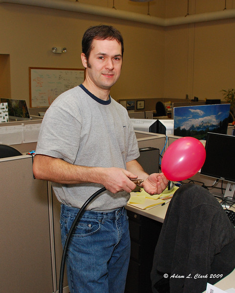 Cubical filled with balloons.  Tim actually doing something, even though it isn't work related.