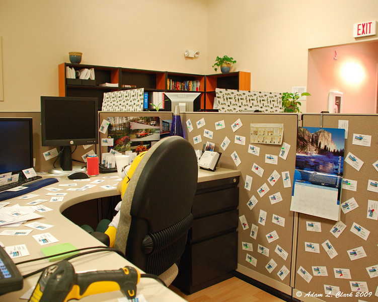 Business cards taped to the desk and thumb tacked to all the cube walls.