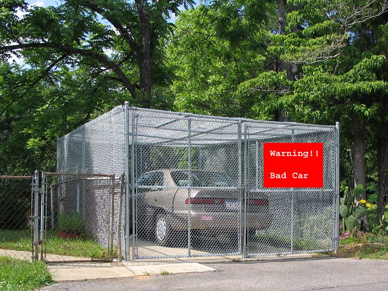 """Normally when I see a cage like this there is a sign saying """"Warning! Bad Dog!"""" <br /> I had to add thesign."""