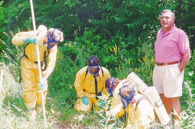 Gee, guys... that seems like an awful lot of protective gear <br /> for such a small chlorine gas leak...
