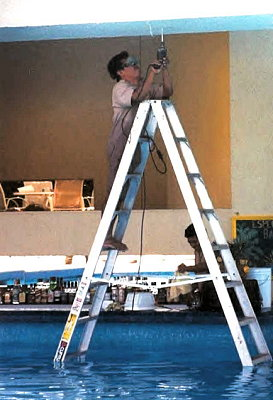 Step 1: Remove shoes. Step 2: Place metal ladder in water. <br /> Step 3: Begin using power tools while standing barefoot on metal ladder in water.