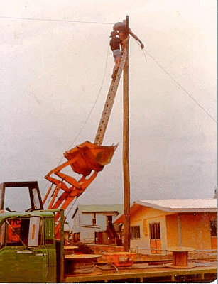 And to think... those wimps at the power company <br /> use straps and cleats to get up this high!