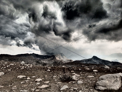 """Stormy day on Mt. Humphrey.  This picture was taken using the """"Dramatic"""" filter on my camera.  We were able to set up our tent just before the deluge of rain and hail started. The lightning was so loud it hurt our ears!"""