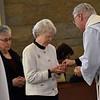 Fr. Jim Walters shares communion