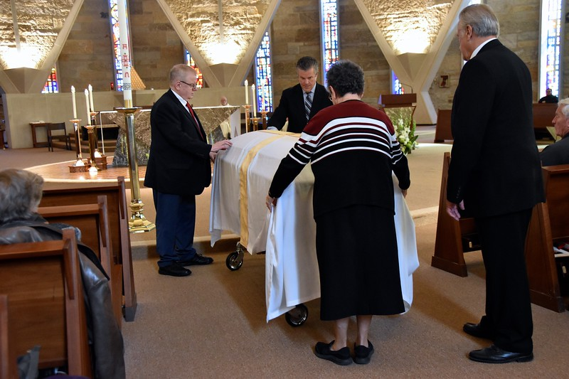 The family prepares the casket