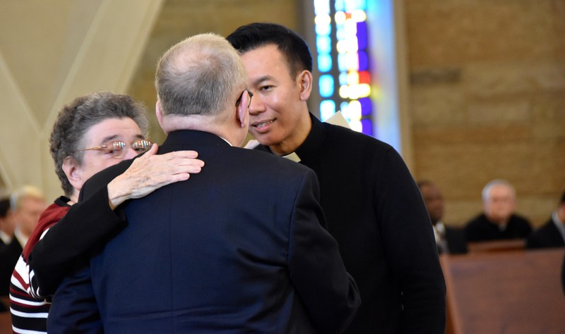 Fr. Vien consoles the family