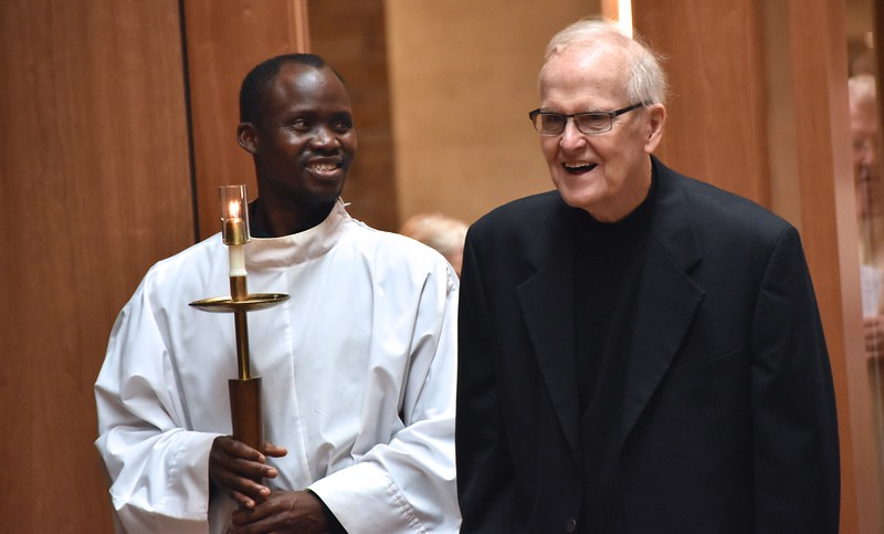 A lighter moment with Fr. Johnny and Novice Hubert before Mass