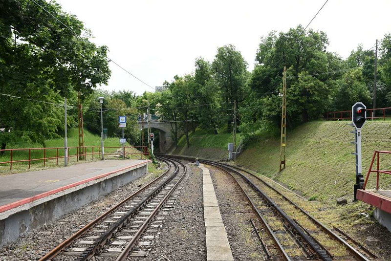Szechenyi-Hegy station, Budapest rack railway, 4 May 2018 1.  Looking east, towards Budapest.  This is the upper terminus of the railway.  It is standard gauge, 3.7km long, electrified at 1500V DC, and uses the Strub rack system.  The station name means Szechenyi hills. The children's railway has a separate terminus nearby.