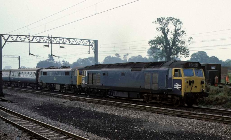 50012 & dead 86250, 1S38, near Norton Bridge, Sun 7 September 1975.  The 0915 Euston - Glasgow.  86250 was exported to Hungary in May 2009.  Photo by Les Tindall.