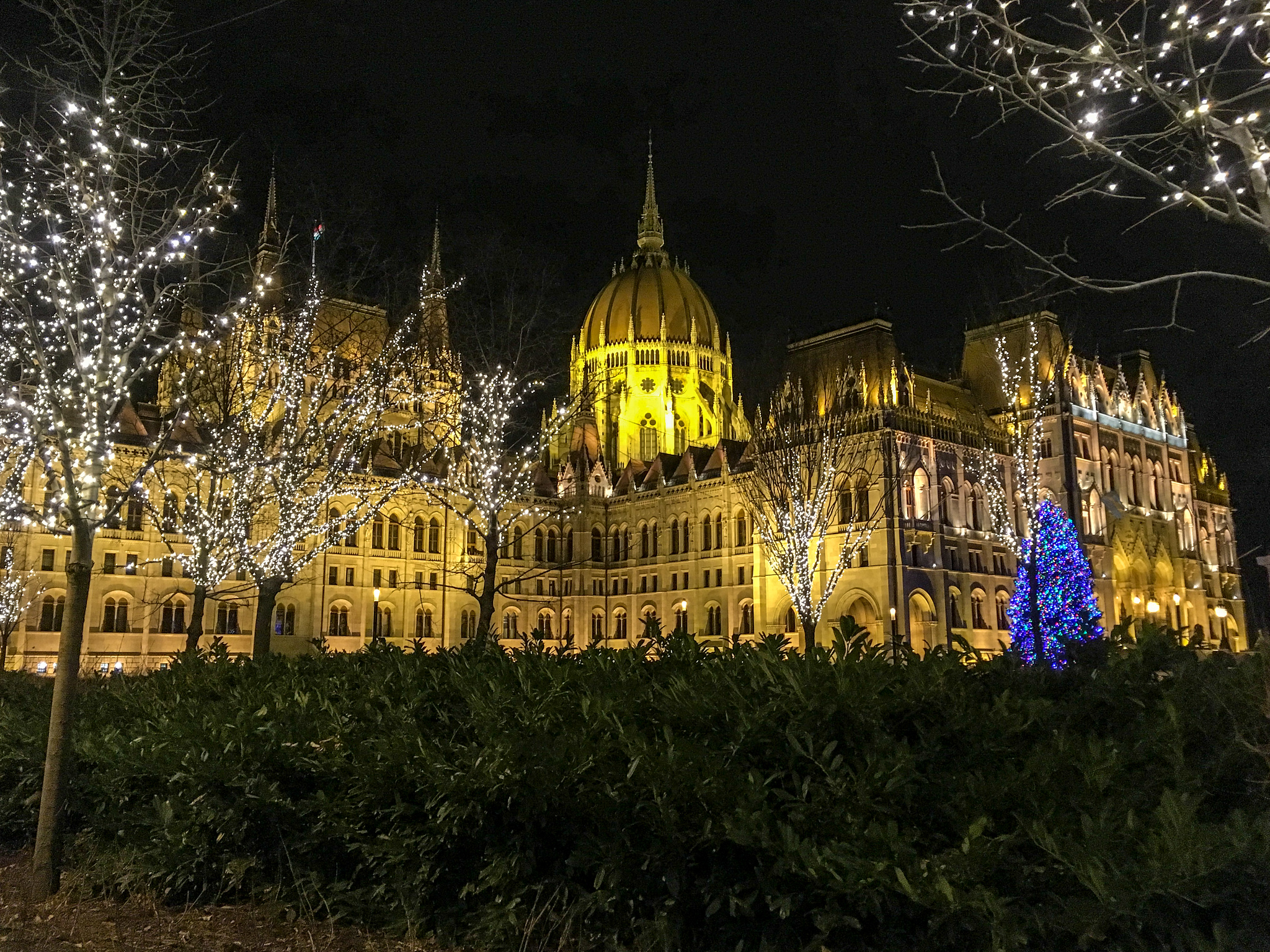 what to wear in budapest in february: stay warm at the parliament at night