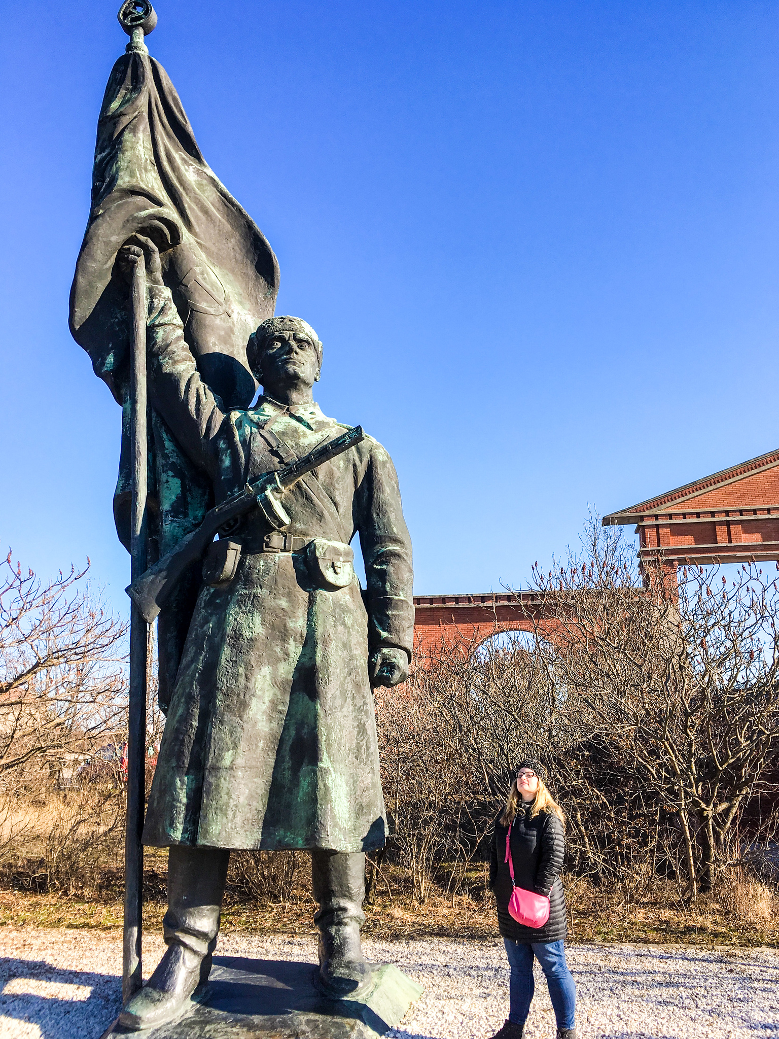 what to wear in budapest in january: something to keep you warm at memento park