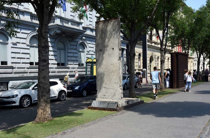 Berlin Wall segment, House of Terror Museum, 60 Andrassy Avenue, Budapest, 12 May 2018.  In June 1989 Hungary opened its border with Austria, allowing East Germans to escape to the West in increasing numbers.  The Berlin Wall subsequently fell on 9 November 1989, paving the way for the collapse of the Soviet Union and its satellite governments, and for German reunification.