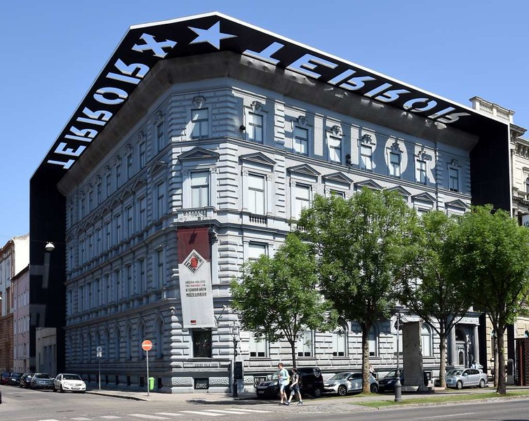 House of Terror Museum, 60 Andrassy Avenue, Budapest, 12 May 2018 2.  The canopy shows the arrow cross and red star badges of the building's successive occupants.
