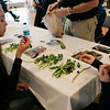 (Saturday March 1st 2014 - Grosse Pointe War Memorial - Ballroom) Survival School atendees Sydney Anderson, 11 (right) and Grace Babiarz 11 (left) both of Grosse Pointe sample some native edible michigan greens as part of the course. Photo by: Brian B. Sevald