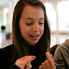 (Saturday March 1st 2014 - Grosse Pointe War Memorial - Ballroom) Survival School atendee Grace Babiarz, 11 of Grosse Pointe holds up a cricket before eating it. Students learned that some insects were edible as part of the course. Photo by: Brian B. Sevald