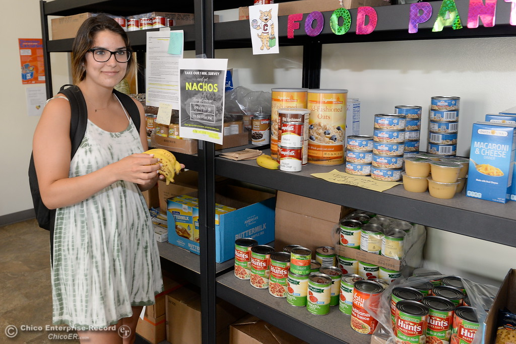 . Samantha Quilici picks up some food at the Hungry Wildcat Food Pantry located at the Student Services Center room 196 on the CSUC campus Tuesday May 8, 2018. (Bill Husa -- Enterprise-Record)