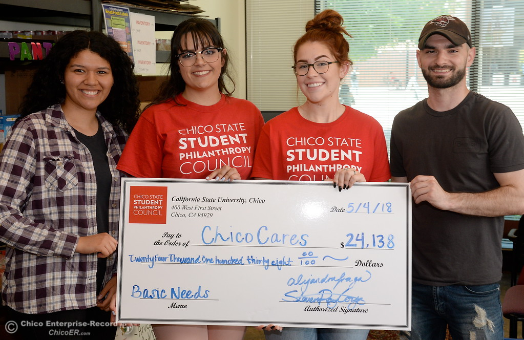 . Left to right, Cal Fresh Outreach Intern Kennedy Valadez, Incoming President of Student Philanthropy Council Kate Gregori, Incoming Vice President of Finance Mimi Baez and Cal Fresh Outreach Intern Spencer Malugani hold a giant check at the Hungry Wildcat Food Pantry located at the Student Services Center room 196 on the CSUC campus Tuesday May 8, 2018. (Bill Husa -- Enterprise-Record)