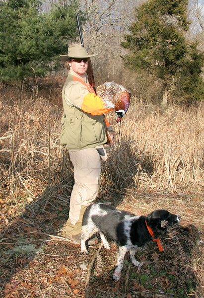 Here we have Buddy with a quality cock pheasant bird and proud Emma not far from the prize.
