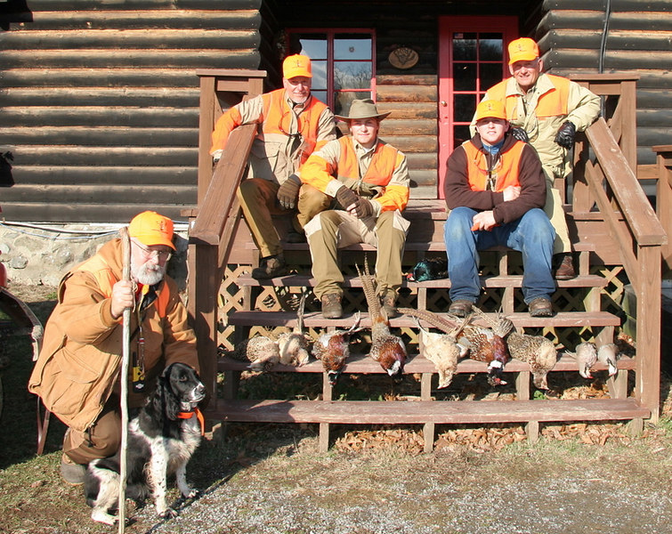 Here is the hunting group for the day.  Tom and his dog Emma, Artie and Buddy Cipoletti, Phil Mascolo and Al Lorenzetti.  Also included is some of the birds we bagged for the day.  We had about 25 pheasants including a beautiful dark blue Mongolian and about a dozen chuckar partirdge.  It was an exciting quality hunt with ideal conditions.  At TMT safety is first but quality hunting with spectacular birds is what it is all about.