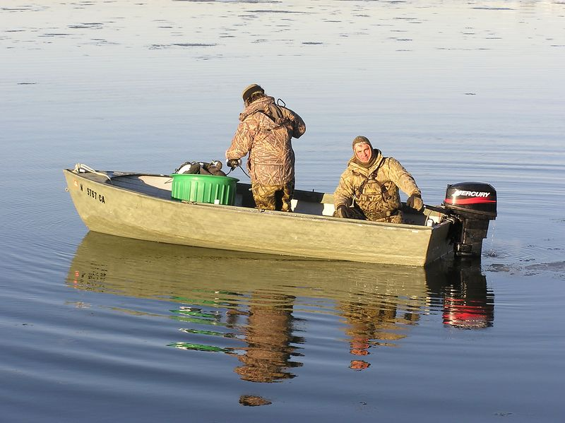 This is Bill and Scott setting the decoys in the early morning after clearing some shooting space out of the ice.  It was worth the trouble as the birds flew real well and all had a good time.  Overall, this past season was not the best.  It started too warm and then got too cold.  There were not many ducks down this way until it got real cold but then the bay froze solid which cut down on the hunting spots that were available.  I look forward to 2005-06 and hopefully it will be better.