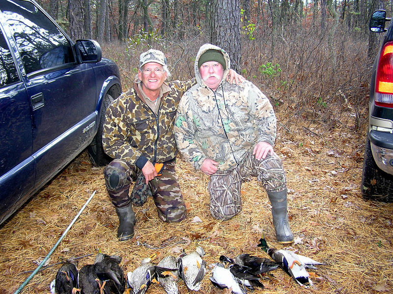 We had some great shooting by the group and of course we missed a few also.  We could not retrieve two birds that made it into the impenetrable swamp across from our blind.  We tried but could not find them.  I hate it when that happens but we did our best.  Pete and I also posed for a photo that Jim took.  As you can see, Jim cut off the bottom of the birds.  He can't see the viewfinder.  Pete is breasting the birds out and we will have a duck feast when we hunt from our camp on one of the islands in the Great South Bay.  A memorable day of hunting and a lot of laughs.<br /> <br /> Captain Al Lorenzetti