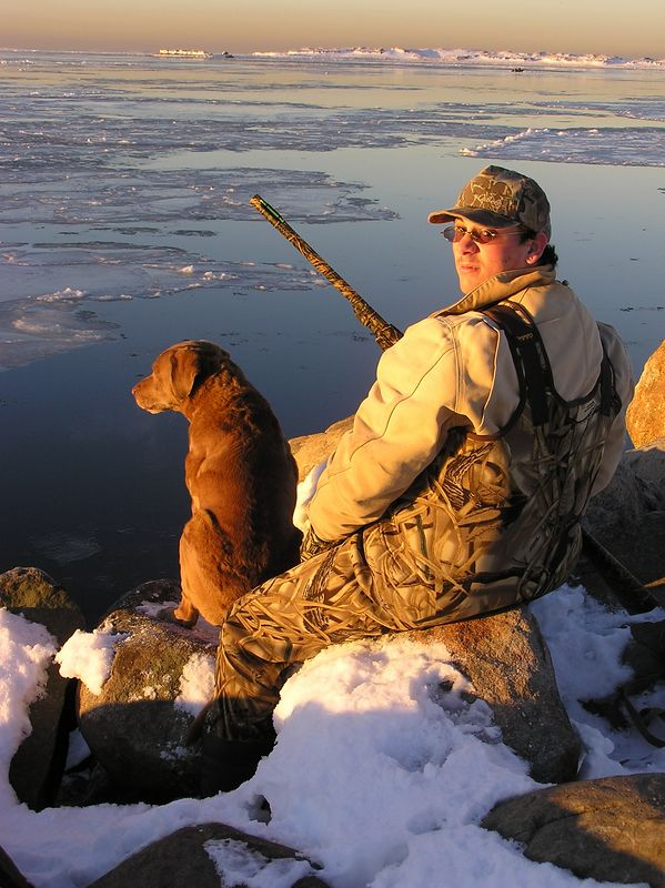 This is a great shot of Dillon Mearns in the morning sun on a real cold day.  It was 8 degrees in the morning with lots of ice to contend with.  The dog is Jake and belongs to Kevin.  Both dogs, Bridie and Jake were incredible at retrieving the ducks.