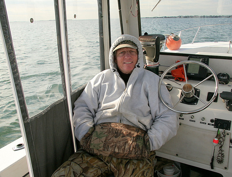 Here is Jim Conte hanging out on his boat that we use as a tender.  As you can see it was a comfortable day but not the best for duck hunting.  However it was fun.  Pete Johnston was also with us but I didn't get a photo of him on this day.  Sorry Pete.