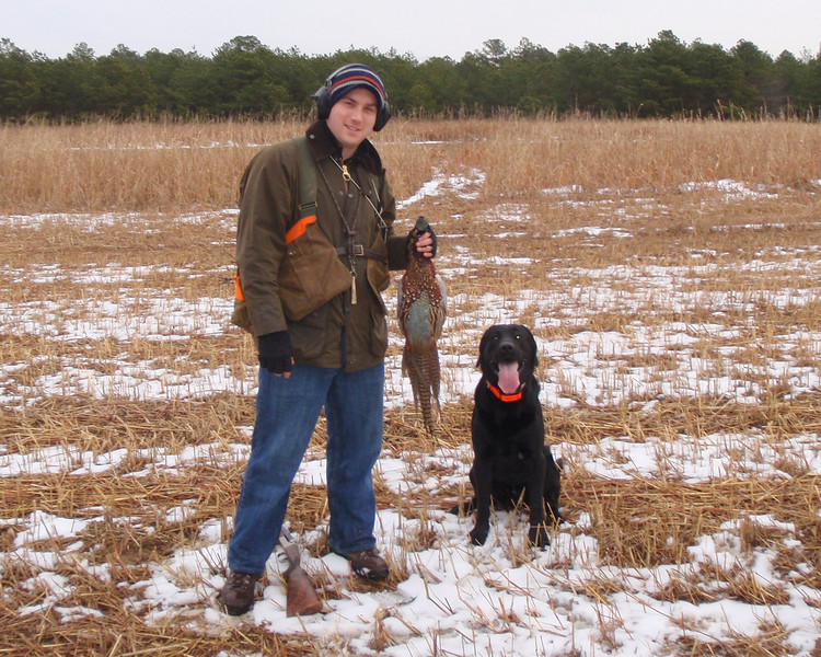 Here is Jimmy and Coal with a beautiful pheasant that Coal raised and retrieved. Proud guy and happy dog.<br /> <br /> It was a great hunt and thank you both.<br /> <br /> Another great day outdoors.<br /> <br /> Captain Al Lorenzetti