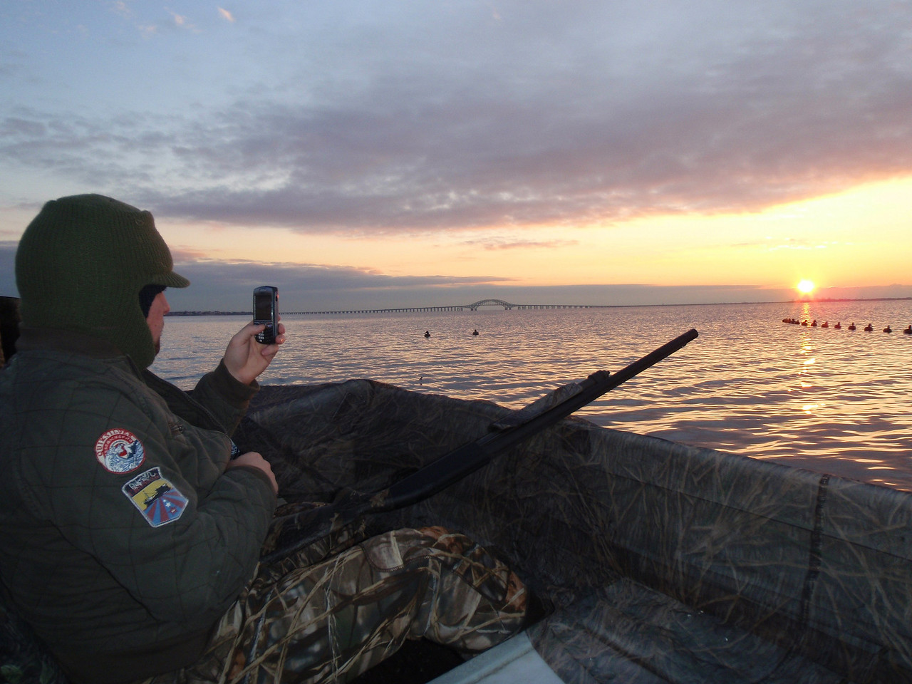 Here is Buddy taking a photo with his cell camera of the decoy layout maybe saving it for future reference. It worked very well.<br /> <br /> Some excellent days on the water.<br /> <br /> Captain Al Lorenzetti