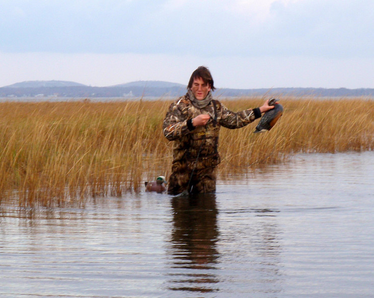 Here is Chris adjusting a couple of Widgeon decoys. We had some widgeon around but they didn't want to come to the decoys. We tried a couple of moves of decoys and boat but it didn't seem to help.