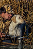 Waterfowl hunter in Vertical Reed camo with Browning Gold shotgun, Yellow lab