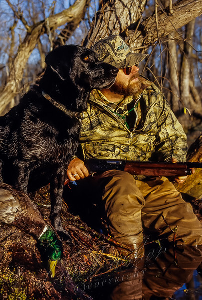 Michael Furtman and his black lab, Rascal, waiting for waterfowl, flooded timber, Backland camo