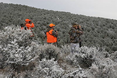 Hunters searching for game.