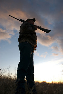 Silhouette of a rifle hunter.  Photo taken 11-28-08, courtesy of Utah Division of Wildlife Resources.