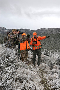 Hunting with binoculars and spotting scope.