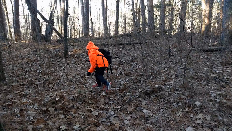 Sitting quiet for 2 hours is hard work for a 6 year old! Hiking out is time to attack the trees with a stick.