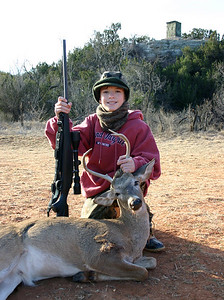 January 2006 - Aaron's first buck with the blind in the background.