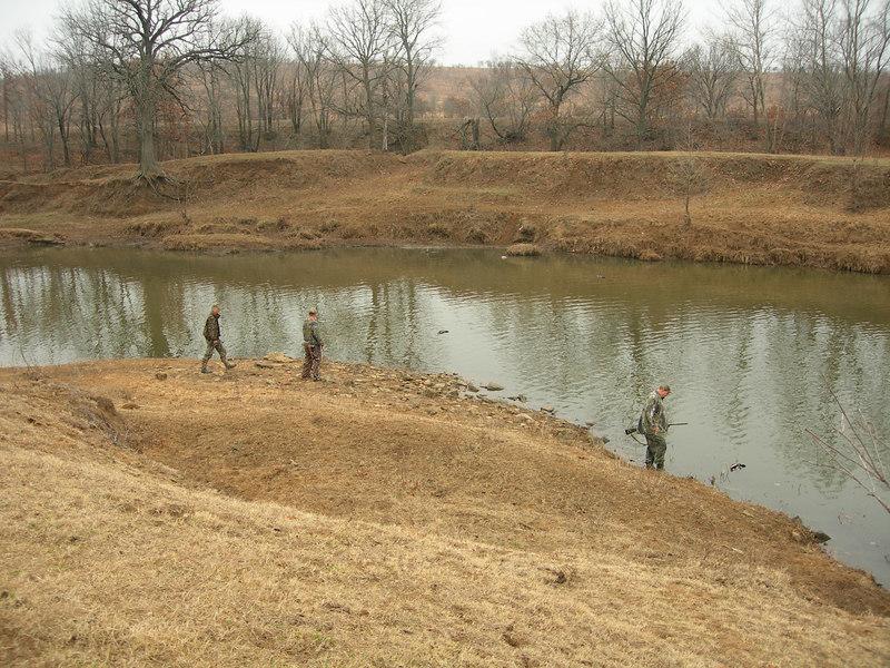 Keith, Joe Allen, and Lonnie retrieving ducks at the Riffles.