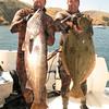 30lbs halibut and Nathaniel for kick held up his big fish.