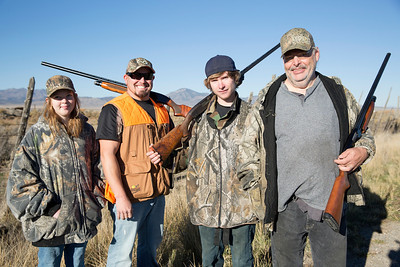 A family enjoys the pheasant hunt opener in 2013. Photo by Michael Christensen, Utah Division of Wildlife Resources.