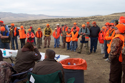 Young hunters and their adult companions gather for instruction before heading afield during a youth pheasant hunt at the Douglas/Sorenson Walk-In Access Area.  Photo by Alan Peterson