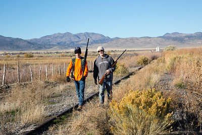A father and son venture out on the opening day of the 2013 pheasant hunt in Utah. Photo by Michael Christensen, Utah Division of Wildlife Resources.