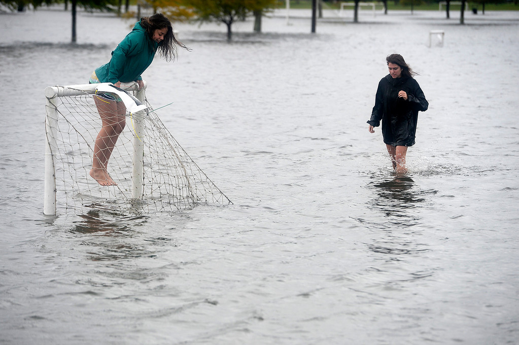 . Abigail Hecht, left, and Alix Neel, both 17, play on the flooded soccer fields at the Cris Quinn Soccer Complex in Beaumont, Texas, Sunday, Aug. 27, 2017. The remnants of Hurricane Harvey sent devastating floods pouring into Houston Sunday as rising water chased thousands of people to rooftops or higher ground. (Ryan Pelham/The Beaumont Enterprise via AP)