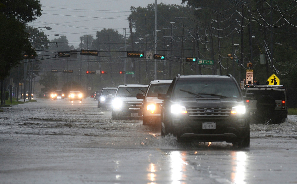 . Water covers much of Beaumont\'s Dowlen Road Sunday morning, Aug. 27, 2017, after the remnants of Hurricane Harvey dumped several inches of water over Southeast Texas. (Guiseppe Barranco/The Beaumont Enterprise via AP)