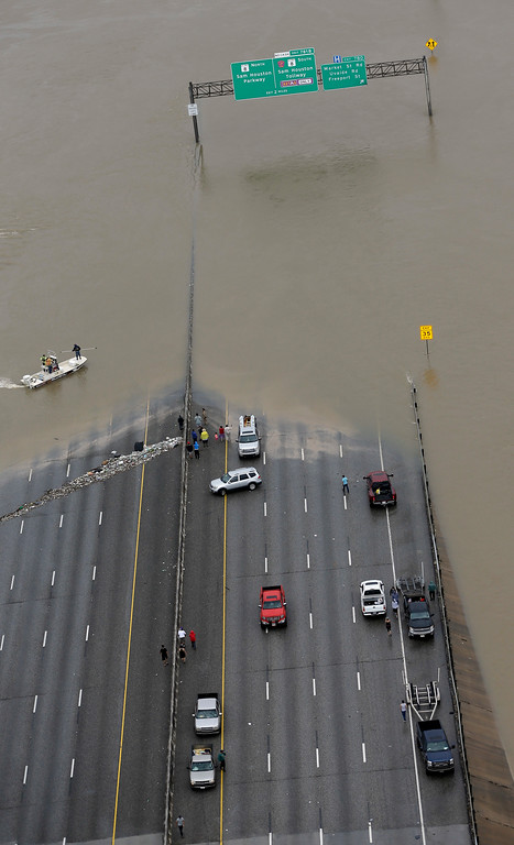 . Interstate 10 is closed due to floodwaters from Tropical Storm Harvey Tuesday, Aug. 29, 2017, in Houston. AP Photo/David J. Phillip