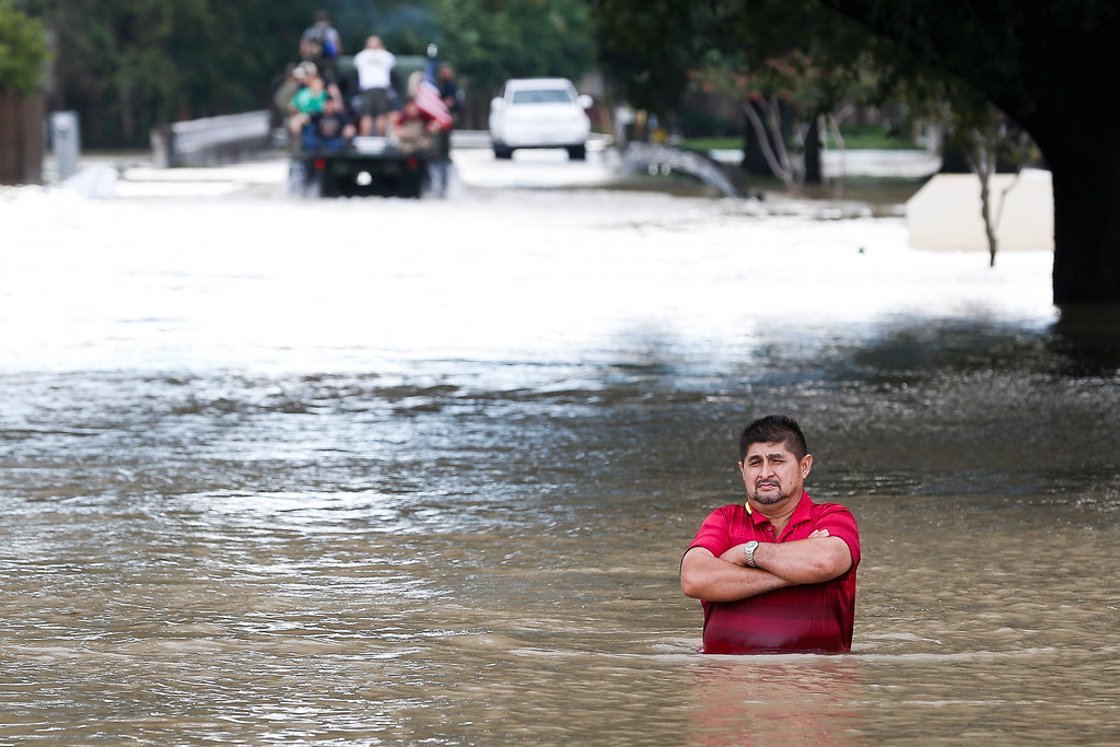 . A man stands in deep flood water along West Little York Road as Addicks Reservoir surpasses capacity due to near constant rain from Tropical Storm Harvey Tuesday, Aug. 29, 2017 in Houston. ( Michael Ciaglo / Houston Chronicle)/Houston Chronicle via AP)