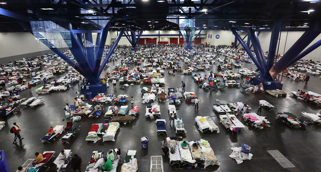 . Evacuees escaping the floodwaters from Tropical Storm Harvey rest at the George R. Brown Convention Center that has been set up as a shelter in Houston, Texas, Tuesday, Aug. 29, 2017. AP Photo/LM Otero