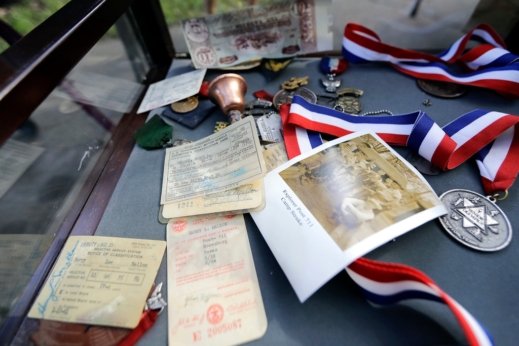 . Pieces of memorabilia belonging to Harry Mellon lie damaged from Tropical Storm Harvey Wednesday, Aug. 30, 2017, in Houston.  Judy Mellon, Harry Mellon\'s wife, watched the storm from a neighbors home across the street which is built up as floodwaters spread through her home. (AP Photo/David J. Phillip)