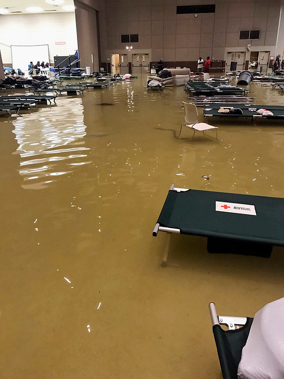 . In this photo provided by Beulah Johnson, cots and belongings sit in high water at the Bowers Civic Center in Port Arthur, Texas, Wednesday, Aug. 30, 2017, after floodwaters caused by Tropical Storm Harvey overcame the faciltiy that was being used as a shelter for those seeking refuge from the storm. Authorities said it\'s not clear where the evacuees will go. (Beulah Johnson via AP)